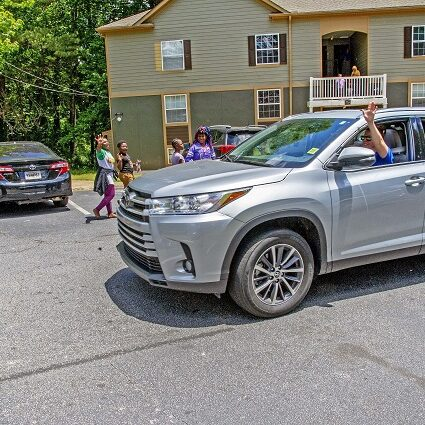 Faculty from the Global Village Project, a school for young refugee women in Decatur, held a car parade through their students' neighborhoods to celebrate their graduation May 16. Photo by Dean Hesse.